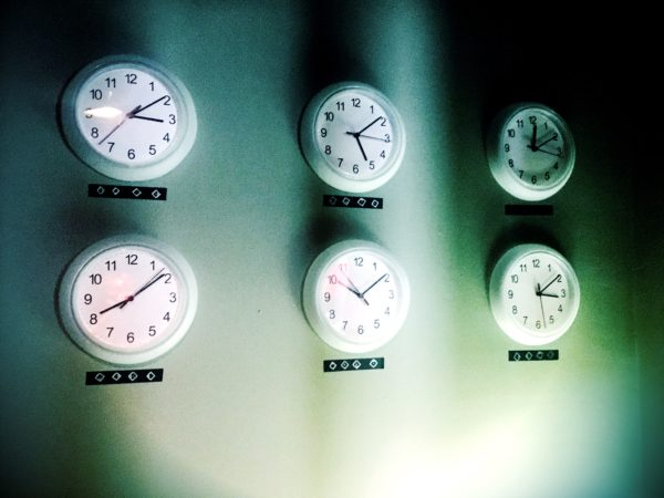 image of six wall clocks showing various time zones