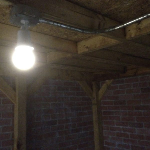 image of light bulb on the ceiling of a creepy cellar
