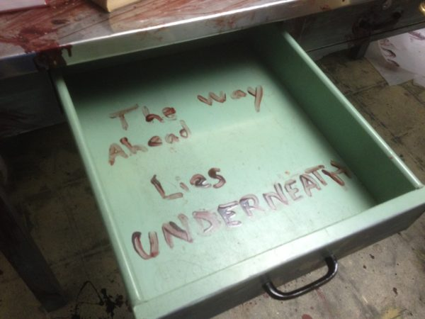 image of open drawer containing the message