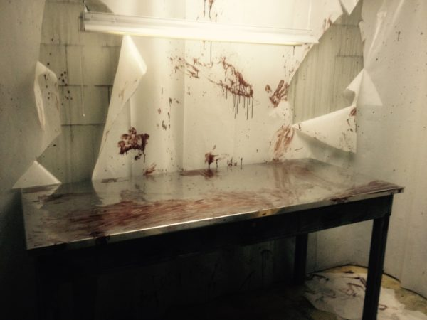 image of stainless steel table with smears of blood